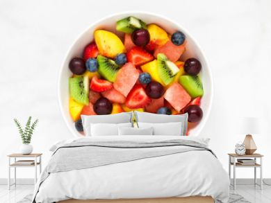 Bowl of healthy fresh fruit salad on white marble background. healthy food