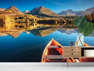 Colorful wooden boats and stunning mountain lake in National Park High Tatra,Strbske Pleso,Slovakia,Europe