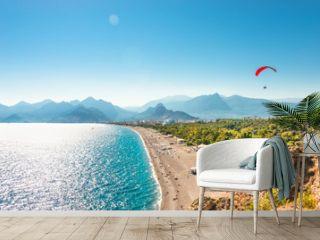 Panoramic bird view of Antalya and Mediterranean seacoast and beach with a paraglider, Antalya, Turkey