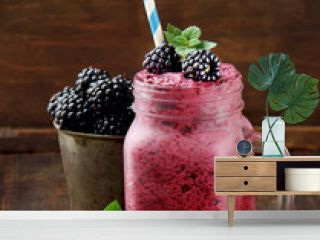 blackberry smoothies juice a tasty healthy drink in a glass jar, drink the morning on  wooden  background.