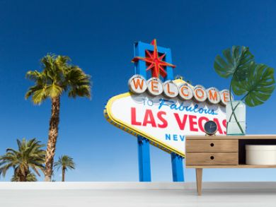 landmarks concept - welcome to fabulous las vegas sign and palm trees over blue sky in united states of america