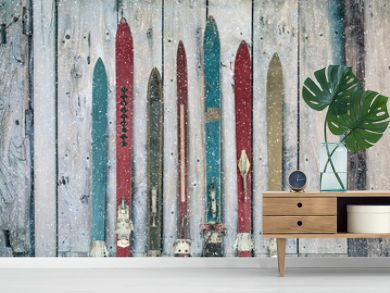 Vintage wooden weathered ski's in winter during snow