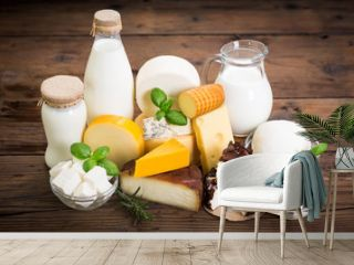 Various types of cheese and dairy product on the wooden table