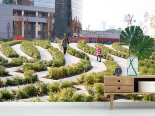 """The """"Porta Nuova """" district in Milan, october 2018. New green public spaces are now open for the city. Green Urban design is a great way to change the image  of a business city"""