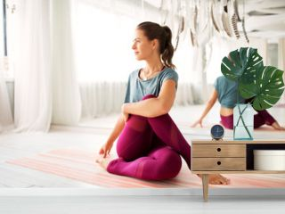 fitness, sport and healthy lifestyle concept - woman doing yoga exercise at studio