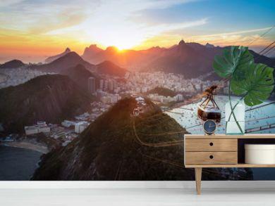 Aerial view of Rio de Janeiro at sunset with Urca and Sugar Loaf Cable Car and Corcovado mountain  - Rio de Janeiro, Brazil