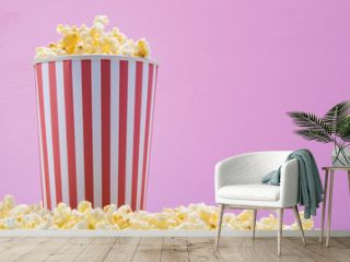 a bucket of popcorn stands on cereal, on a pink background, on the right there is a place to write