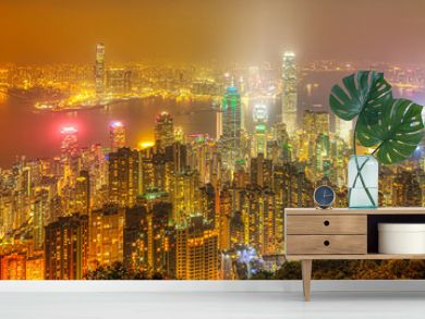 Hong Kong night panorama wide view of Victoria Harbour skyline from Victoria Peak. The Peak is the highest mountain in Hong Kong Island of China.