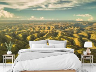 Aerial panorama green hills. Drone shot. Indonesia. Breathtaking landscape hilly surface on the blue cloudy sky background. Sumba island. Magnificient beauty of wild virgin nature.