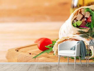 Tortillas wraps with chicken and vegetables on  wooden background. Chicken burrito. Banner. Healthy food.