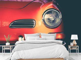 Karmann Ghia orange oldtimer shown to the detail in artistic way