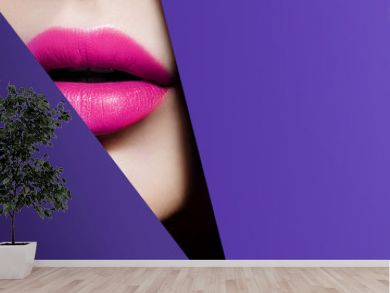 Plump bright pink lips in violet paper frame. Close up beauty photo. Geometry and minimalism. Creative fashion makeup