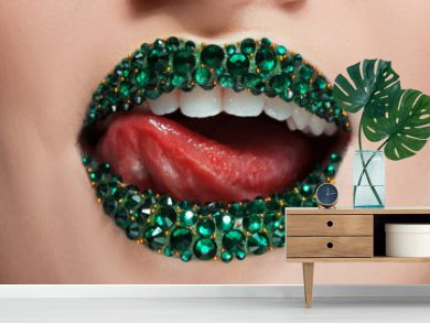 Green lips covered with rhinestones. Beautiful woman with Green lipstick on her lips