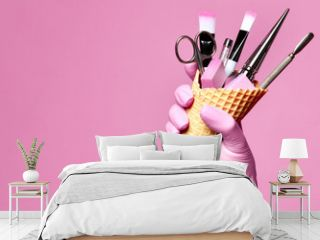 Manicure and pedicure abstract concept. Hand hold  waffles cone with instruments for nails salon and spa brush nail file