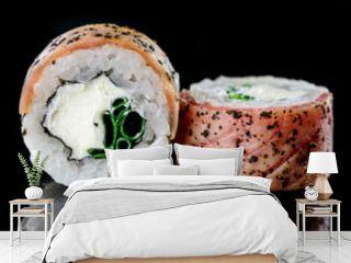 baked hot sushi rolls on a dark background. Hot fried Sushi Roll Sushi menu