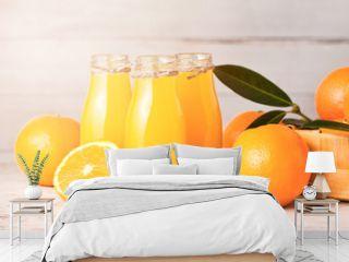 Glass bottles of raw organic fresh orange juice