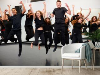 Male And Female Students At Performing Arts School Rehearsing Street Dance In Studio
