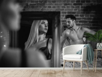 Sensual couple relaxing in a modern, stylish apartment