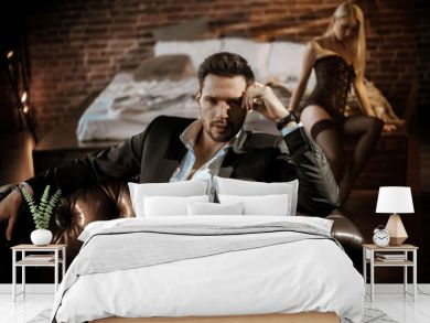 Handsome man relaxing in the luxurious apartment with a sensual woman