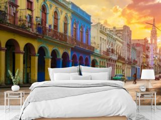 Classic car and colorful buildings  in Havana at sunset