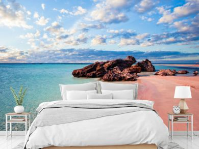 Crete skyline. Elafonissi beach with pink sand against blue sky with clouds on Crete, Greece
