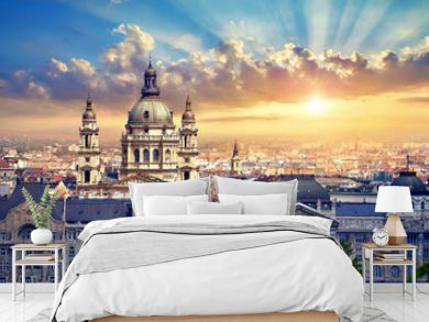 Urban landscape panorama with sunset and old buildings and domes of opera buildings in Budapest, Hungary.