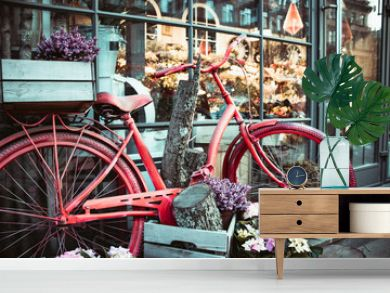 Summer landscape with a bike in the style of Provence. Urban bike parked to a flower shop. Bicycle with a basket for flowers stands near a beautiful place.