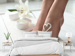 Woman with beautiful feet and cream on white towel, closeup. Spa treatment