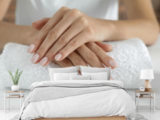 Woman showing smooth hands on towel, closeup. Spa treatment