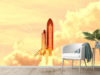 Powerful rocket is flying through the clouds to stars. Elements of this image furnished by NASA.