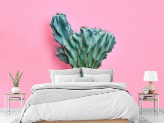 Fashion Blue Cactus Coral colored pastel background. Trendy tropical plant close-up. Art Concept. Creative Style. Sweet coral fashionable cactus Mood
