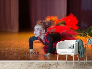 A little girl performs a dance number.Little girl dancing