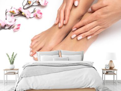 Female feet and hands with nice pedicure and manicure isolated on white background.