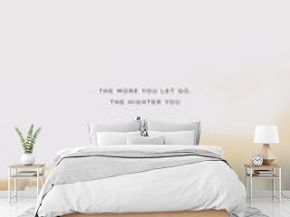 """Miminalist quote design with typography """"The more you let go, the highter you rise"""", motivational text  on nature background, white flowers field. Low contrast, low saturation, shades of grey."""