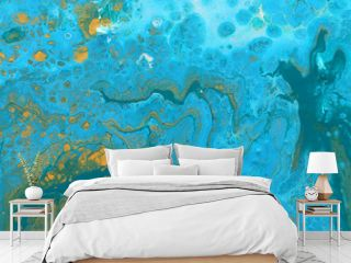 photography of abstract marbleized effect background. Blue, mint and white creative colors. Beautiful paint with the addition of gold