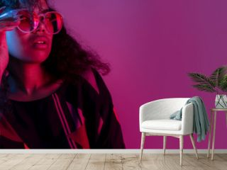 Fashion young african girl black woman wear stylish pink sunglasses glasses looking at camera isolated on party purple studio background, horizontal banner for website design, portrait, copy space