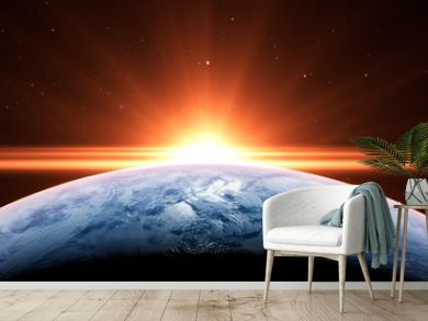 Sunrise over the planet Earth concept with a bright sun and flare and city lights panoramic