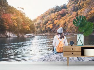 Young woman traveler looking beautiful landscape at arashiyama Japan, Travel lifestyle concept
