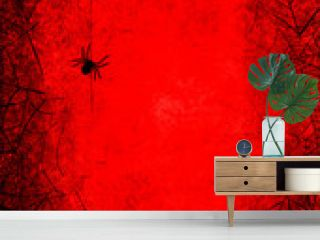 Halloween holiday bloody red grunge background with silhouettes of spider and webs