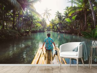 Palm tree jungle in the philippines. concept about wanderlust tropical travels. swinging on the river. People having fun