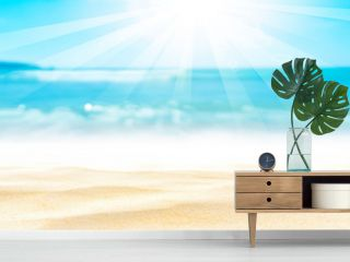 Panorama view of blur beautiful tropical beach with bokeh sun light wave abstract background.