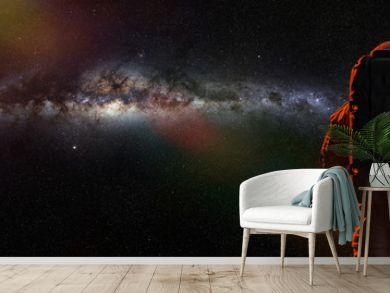 standing astronaut in front of the beautiful Milky Way galaxy