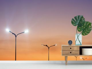 Urban landscape with modern minimal street lights and vibrant sky