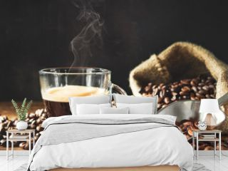 Cup of espresso with coffee beans