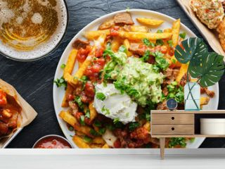 top down photo of carne asada fries and buffalo chicklen wings