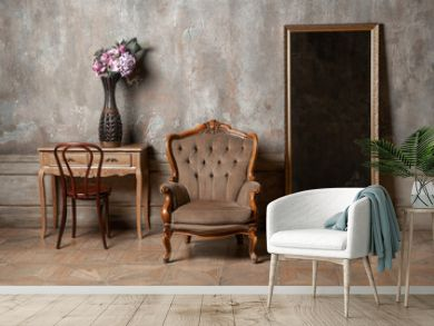 old chair, a mirror and a table with flowers on background of vintage wall