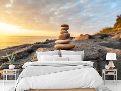 Stones pyramid on the seashore at sunset