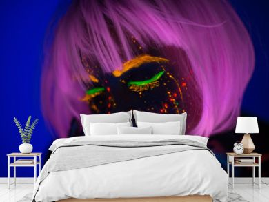 Portrait of Beautiful Fashion Woman in Neon UF Light. Model Girl with Fluorescent Creative Psychedelic MakeUp, Art Design of Female Disco Dancer Model in UV, Colorful Abstract Make-Up. Dancing Lady