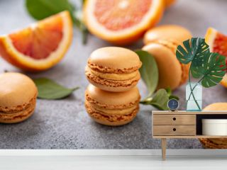 Blood orange french macarons with fresh fruit on the table