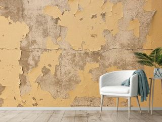 The ancient yellow background of natural cement or cracked surfaces from a long service life. Retro style wall
